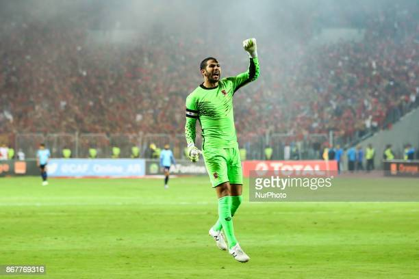 AlAhly's goalkeeper Sherif Ekramy reacts during the CAF Champions League final football match between AlAhly and Wydad Casablanca at the Borg El Arab...