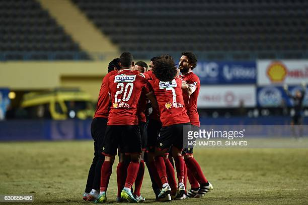 AlAhly's players celebrate after scoring a goal during their Egyptian Premier League football match against Zamalek at Petrosport Stadium in Cairo on...
