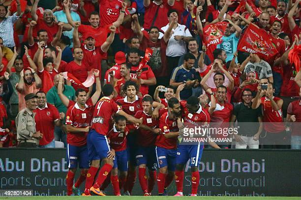 AlAhly's players celebrate after scoring a second goal during the Egypt super cup football match between AlAhly SC and Zamalek Egyptian football...