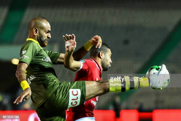 Alahly's Sabry Rahel and AlAssuite sport Said Morad fight for the ball during the Egypt Primer League Fixtures 9 match between AlAhly and AlAssuite...