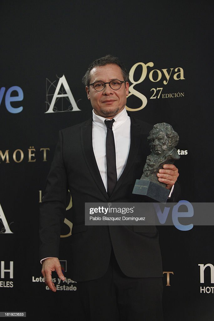 Alain Bainee holds his award for Best Artistic Direction in the film 'Blancanieves' during the 2013 edition of the 'Goya Cinema Awards' ceremony at Centro de Congresos Principe Felipe on February 17, 2013 in Madrid, Spain.