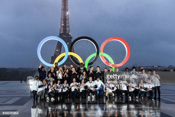 Alain Bernard Pascal Gentil Estelle Mossely celebrate the attribution during olympic day celebrations for Paris 2024 at trocadero on September 13...