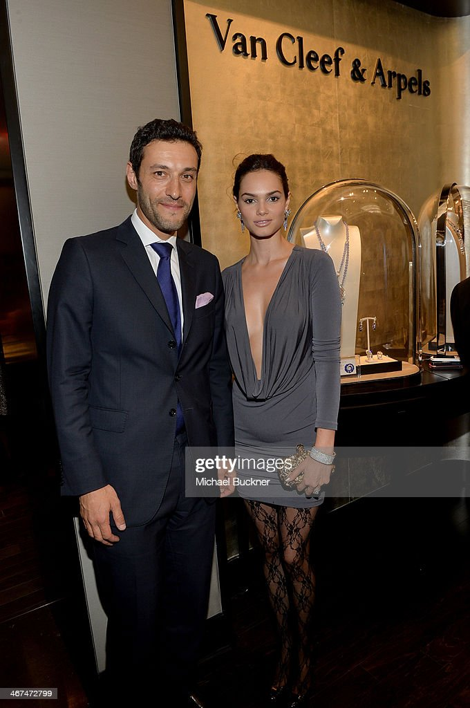 Alain Bernard, President and CEO of The Americas for Van Cleef & Arpels (L) and model <a gi-track='captionPersonalityLinkClicked' href=/galleries/search?phrase=Lisalla+Montenegro&family=editorial&specificpeople=5686484 ng-click='$event.stopPropagation()'>Lisalla Montenegro</a> attend the celebration of Van Cleef & Arpels newly re-designed South Coast Plaza Boutique at Van Cleef & Arpels on February 6, 2014 in Orange County, California.