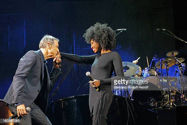 Alain Chamfort kisses the hand of Inna Modja after they performed at Le Grand Rex on January 30 2013 in Paris France