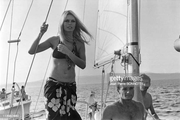 Alain Delon and Brigitte Bardot in Saint Tropez France in August 1968Alain Delon Brigitte Bardot and EricTabarlyin SaintTropez