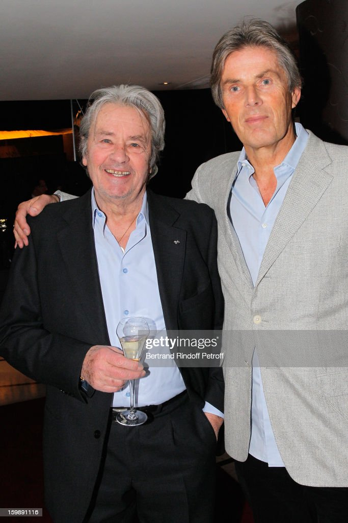 <a gi-track='captionPersonalityLinkClicked' href=/galleries/search?phrase=Alain+Delon&family=editorial&specificpeople=228460 ng-click='$event.stopPropagation()'>Alain Delon</a> (L) and Dominique Desseigne attend 'La Petite Maison De Nicole' Inauguration Cocktail at Hotel Fouquet's Barriere on January 22, 2013 in Paris, France.