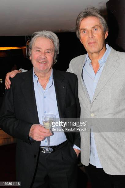 Alain Delon and Dominique Desseigne attend 'La Petite Maison De Nicole' Inauguration Cocktail at Hotel Fouquet's Barriere on January 22 2013 in Paris...