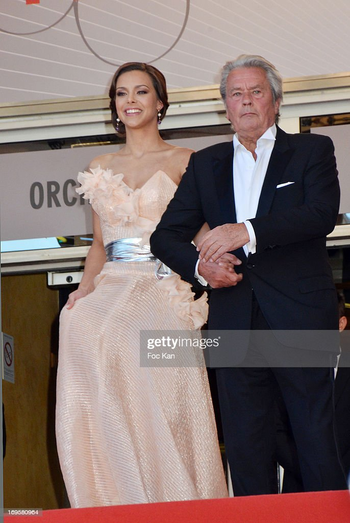 Alain Delon (R) and Marine Lorphelin attend the Premiere of 'Zulu' and the Closing Ceremony of The 66th Annual Cannes Film Festival at Palais des Festivals on May 26, 2013 in Cannes, France.