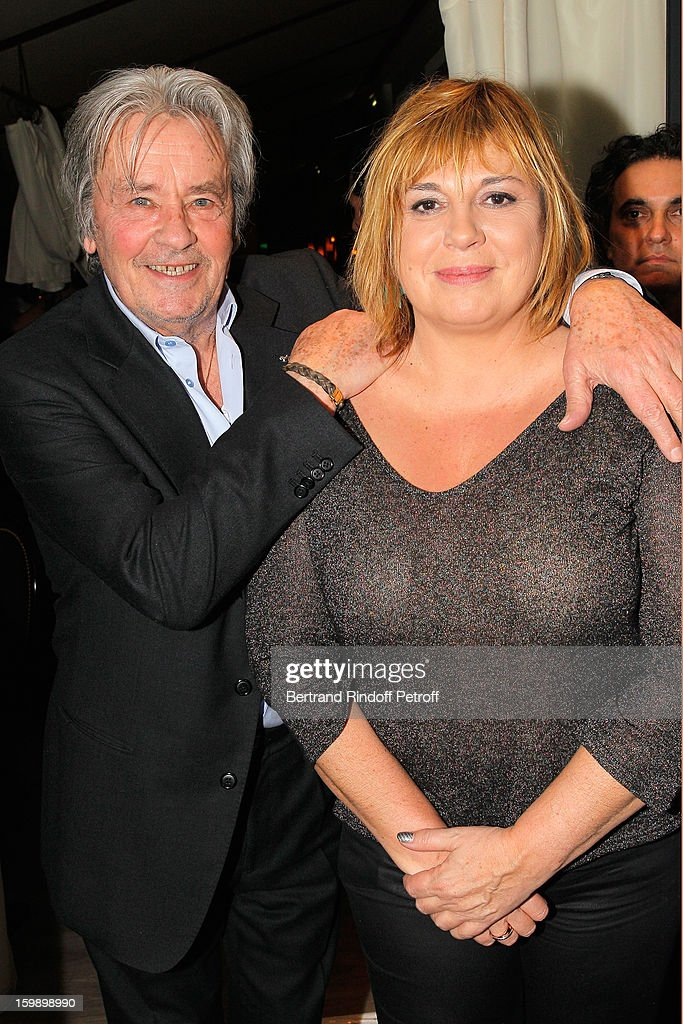 <a gi-track='captionPersonalityLinkClicked' href=/galleries/search?phrase=Alain+Delon&family=editorial&specificpeople=228460 ng-click='$event.stopPropagation()'>Alain Delon</a> (L) and Michele Bernier attend 'La Petite Maison De Nicole' Inauguration Cocktail at Hotel Fouquet's Barriere on January 22, 2013 in Paris, France.