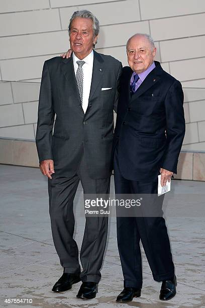 Alain Delon and Pierre Berge attend the Foundation Louis Vuitton Opening at Foundation Louis Vuitton on October 20 2014 in BoulogneBillancourt France
