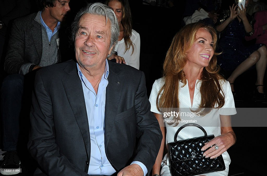 <a gi-track='captionPersonalityLinkClicked' href=/galleries/search?phrase=Alain+Delon&family=editorial&specificpeople=228460 ng-click='$event.stopPropagation()'>Alain Delon</a> (L) and Rosalie van Breemen attend the Elie Saab Spring/Summer 2013 show as part of Paris Fashion Week at Espace Ephemere Tuileries on October 3, 2012 in Paris, France.