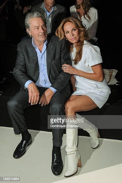 Alain Delon and Rosalie van Breemen attend the Elie Saab Spring/Summer 2013 show as part of Paris Fashion Week at Espace Ephemere Tuileries on...