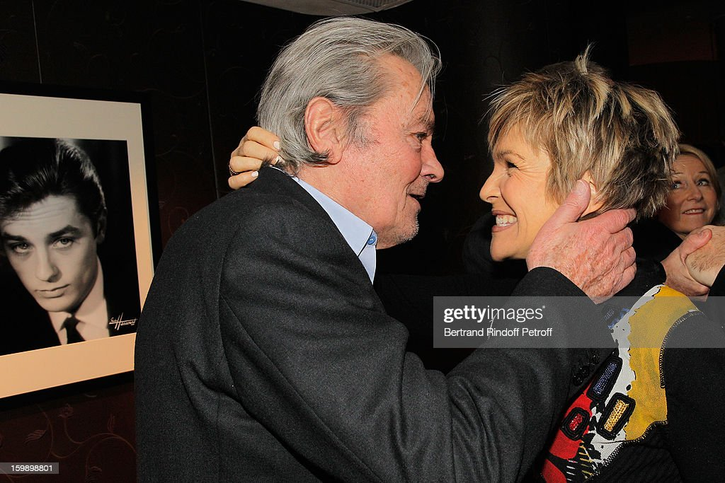 <a gi-track='captionPersonalityLinkClicked' href=/galleries/search?phrase=Alain+Delon&family=editorial&specificpeople=228460 ng-click='$event.stopPropagation()'>Alain Delon</a> (L) and Veronique Jannot attend 'La Petite Maison De Nicole' Inauguration Cocktail at Hotel Fouquet's Barriere on January 22, 2013 in Paris, France.