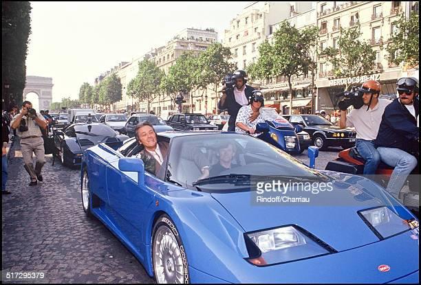 Risultati immagini per 03 Alain Delon for the Presentation of the Bugatti Eb 110 sport car on the Champs Elysees.jpg