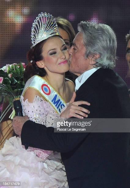 Alain Delon kisses Delphine Wespiser as she celebrates being crowned Miss France 2012 on December 3 2011 in Brest France