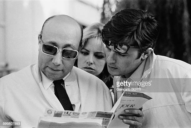 Alain Delon Nathalie Delon and director JeanPierre Melville on the set of his crime thriller film 'The Samourai' in France in July 1967