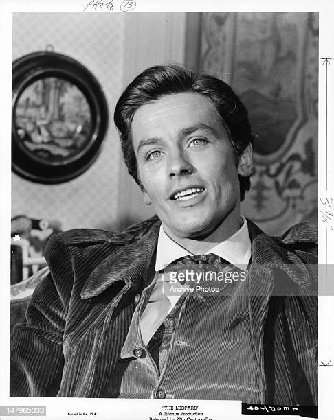 Alain Delon sitting back in a scene from the film 'The Leopard' 1963