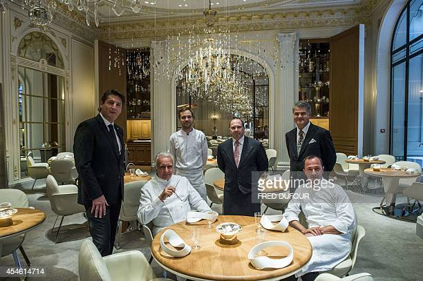 GIFFARD Alain Ducasse the godfather of French gastronomy poses in his restaurant at the Plaza Athenee hotel in Paris flanked by head sommelier Gerard...