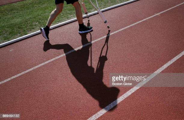 J Alain Ferry uses a pair of crutches and a stability brace while working out at McCurdy Track in Boston's Allston neighborhood on Apr 13 2017 Ferry...