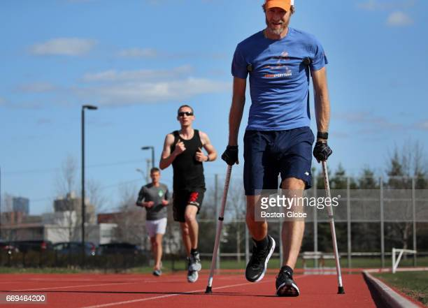 J Alain Ferry uses a pair of crutches and a stability brace while working out at McCurdy Track Boston's Allston neighborhood on Apr 13 2017 Ferry...