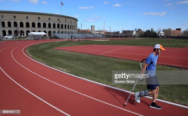 J Alain Ferry uses a pair of crutches and a walking boot while working out at McCurdy Track Boston's Allston neighborhood on Apr 13 2017 Ferry broke...
