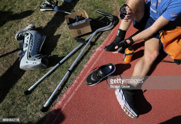 J Alain Ferry works out with a walking boot various crutches and a stability brace at McCurdy Track in Boston's Allston neighborhood on Apr 13 2017...