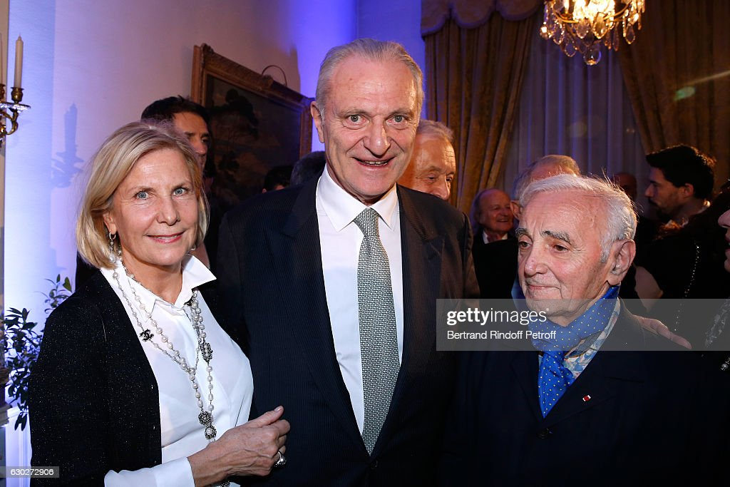 Alain Flammarion, hiw wife Suzanne and Charles Aznavour attend Nana Mouskouri gives the Greek Prize 'Nikos Gatsos 2016' to Charles Aznavour at Embassy of Greece on December 19, 2016 in Paris, France.