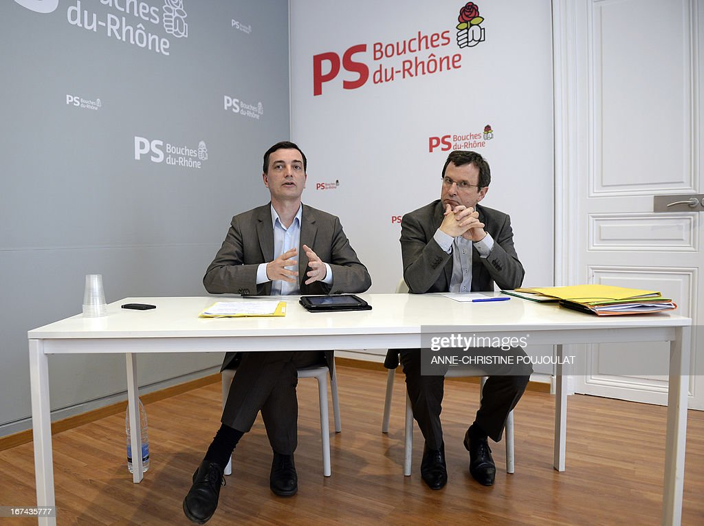Alain Fontanel (L) and Christophe Borgel, the administrators of the Socialist Party (PS) federation of the Bouches-du-Rhone give a press conference on April 25, 2013 in Marseille, southern France. They announced that a primary vote opened to other left parties will be organised next October for the French 2014 local elections in Marseille. AFP PHOTO / ANNE-CHRISTINE POUJOULAT