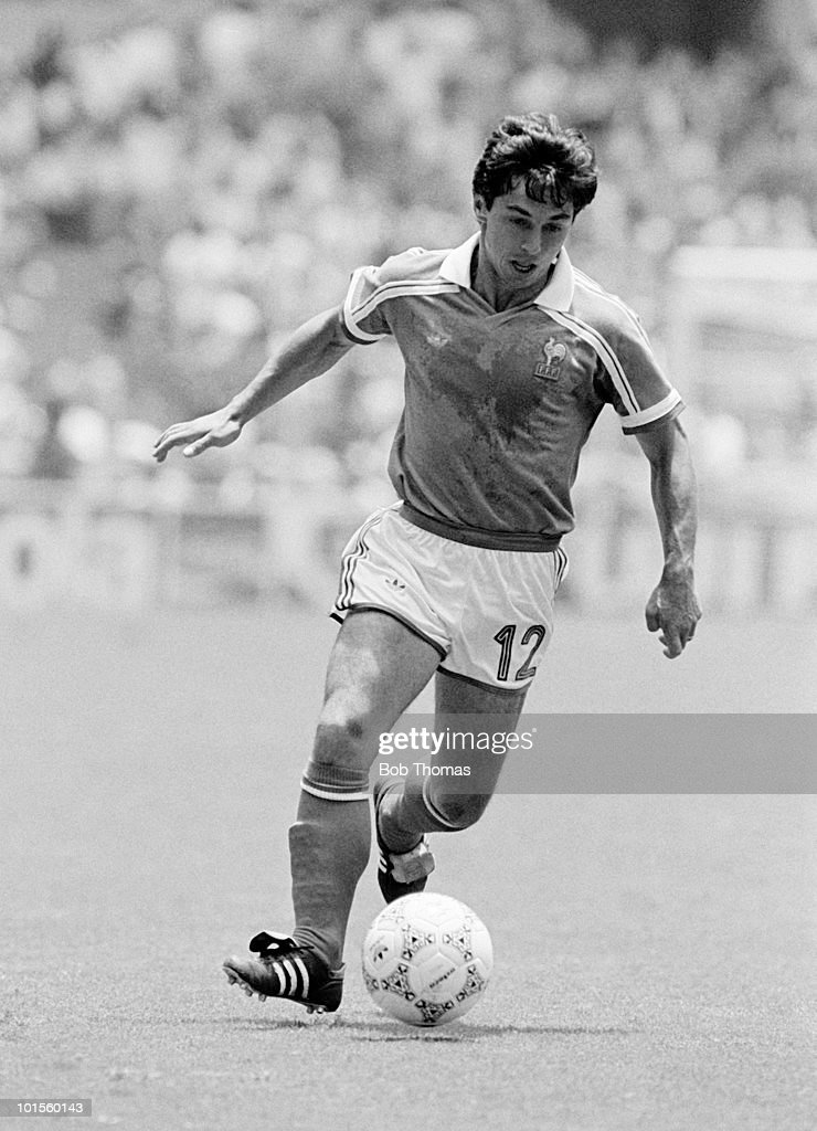 Alain Giresse in action for France in their World Cup Quarter-Final match against Brazil held at the Estadio Tres de Marzo in Guadalajara, Mexico on 21st June 1986. After drawing 1-1 after extra time, France beat Brazil 4-3 on penalties. (Bob Thomas/Getty Images).