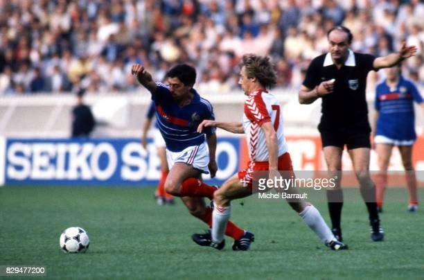 Alain Giresse of France and Jens Jorn Bertelsen of Denmark during the European Championship match between France and Denmark at Parc des Princes...