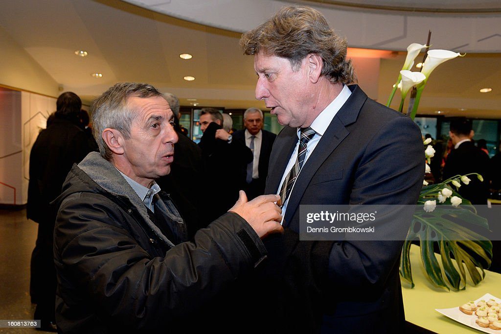 Alain Giresse of France and Toni Schumacher of Germany exchange words during a meeting of the 1982 World Cup teams of France and Germany on February 6, 2013 in Paris, France.