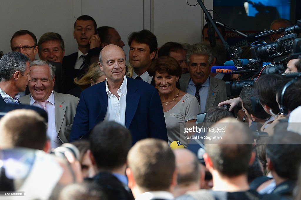 Alain Gournac (L) and <a gi-track='captionPersonalityLinkClicked' href=/galleries/search?phrase=Alain+Juppe&family=editorial&specificpeople=235359 ng-click='$event.stopPropagation()'>Alain Juppe</a> depart the UMP headquarters after an extraordinary meeting of UMP right-wing opposition party July 8, 2013 in Paris, France.