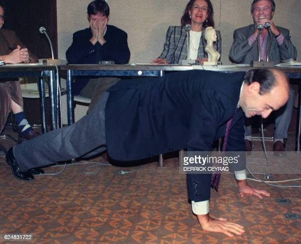 Alain Juppe general secretary of the RPR party and deputy mayor of Paris does pushups while telling a joke which earned him the 'Marianne du Rire'...