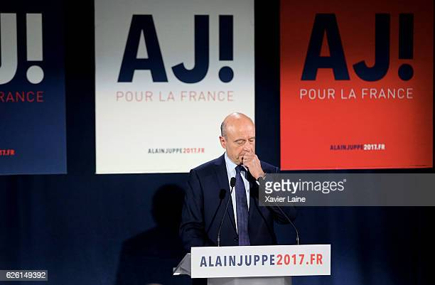 Alain Juppe looks disappointed as he speaks after his defeat after the RightWing primary elections ahead of 2017 Presidential elections at his...