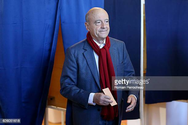 Alain Juppe Mayor of Bordeaux and Les Republicains presidential candidate hopeful votes during the second round of voting in the Republican Party's...