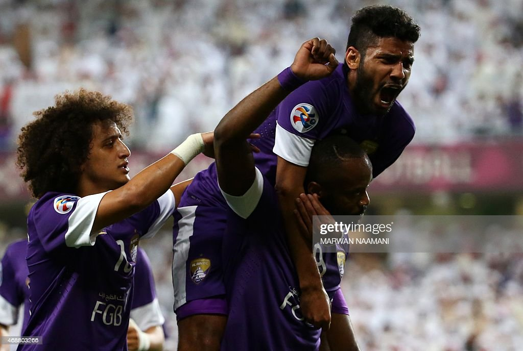 UAE al-Ain players <a gi-track='captionPersonalityLinkClicked' href=/galleries/search?phrase=Omar+Abdulrahman&family=editorial&specificpeople=6420654 ng-click='$event.stopPropagation()'>Omar Abdulrahman</a> (L) and Rashed Eisa (top) congratulate <a gi-track='captionPersonalityLinkClicked' href=/galleries/search?phrase=Jires+Kembo+Ekoko&family=editorial&specificpeople=4444013 ng-click='$event.stopPropagation()'>Jires Kembo Ekoko</a> (C) for scoring his goal during the AFC Champions League Group B football match between Uzbekistan's Pakhtakor and UAE's Al-Ain at the Hazza Bin Zayed stadium in Al-Ain on April 7, 2015.