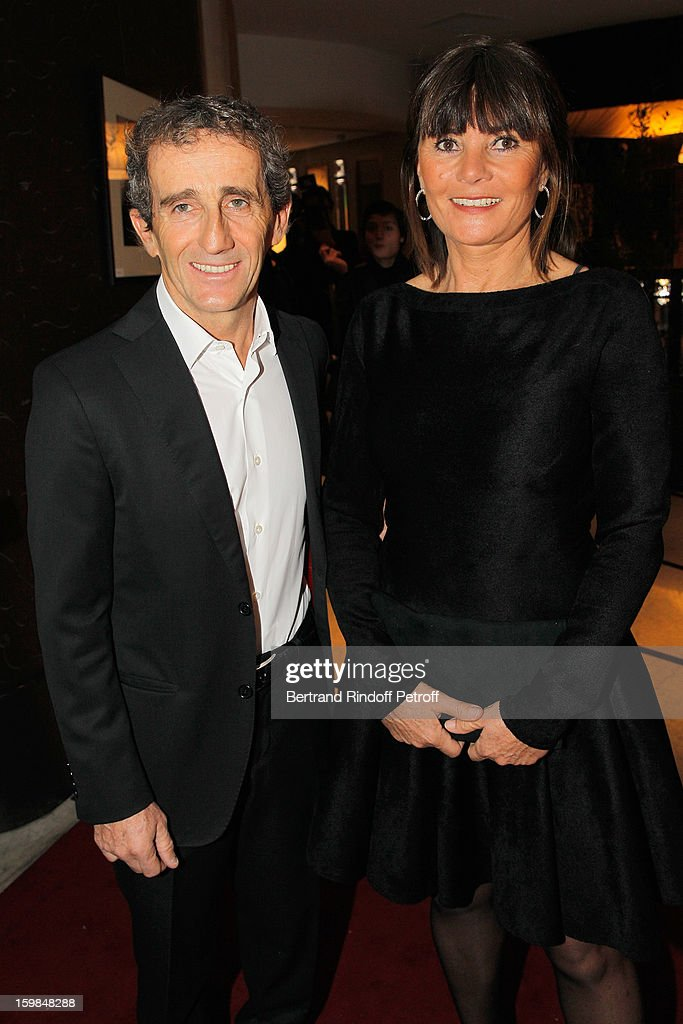 Alain Prost (L) and his wife attend 'La Petite Maison De Nicole' Inauguration Cocktail at Hotel Fouquet's Barriere on January 21, 2013 in Paris, France.