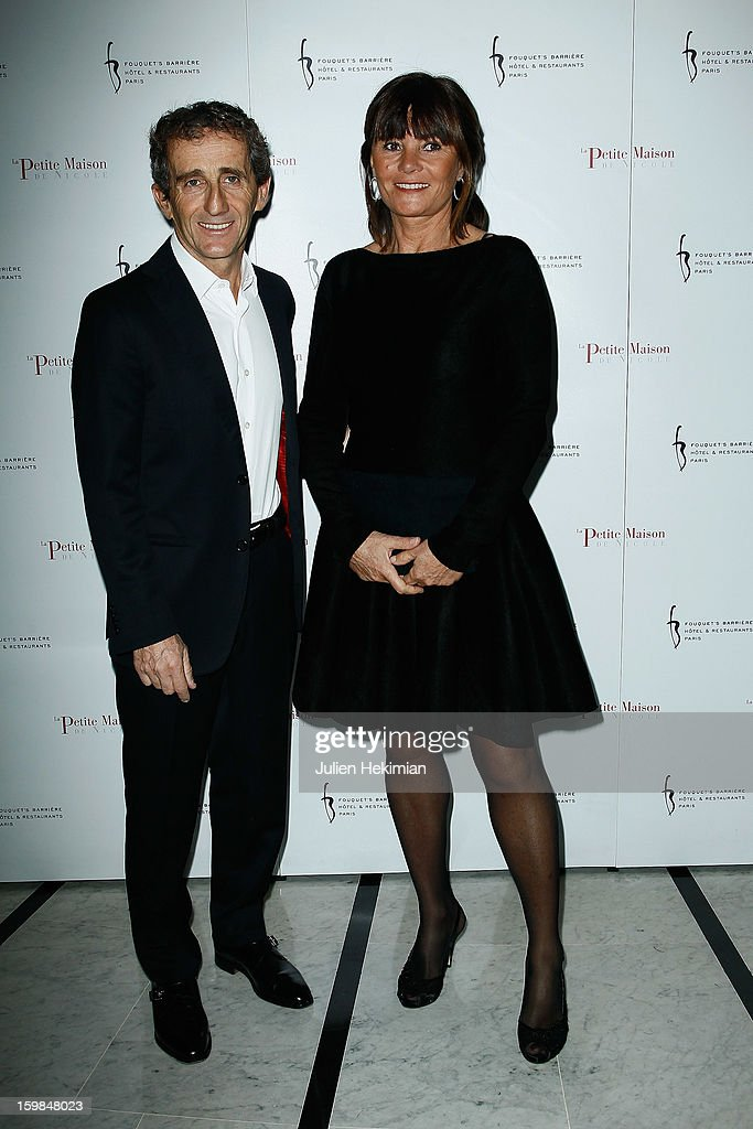 <a gi-track='captionPersonalityLinkClicked' href=/galleries/search?phrase=Alain+Prost&family=editorial&specificpeople=200667 ng-click='$event.stopPropagation()'>Alain Prost</a> and his wife attend 'La Petite Maison De Nicole' Inauguration Photocall at Hotel Fouquet's Barriere on January 21, 2013 in Paris, France.