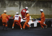 Alain Prost climbs from the Marlboro McLarenHonda MP4/5 after controversially colliding with his team mate Ayrton Senna during the Japanese Grand...