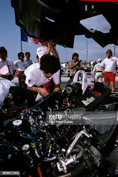 Alain Prost McLarenHonda MP4/4 Grand Prix of France Circuit Paul Ricard July 3 1988 A Honda mechanic works on the Honda RA168E 15 V6 turbo engine of...