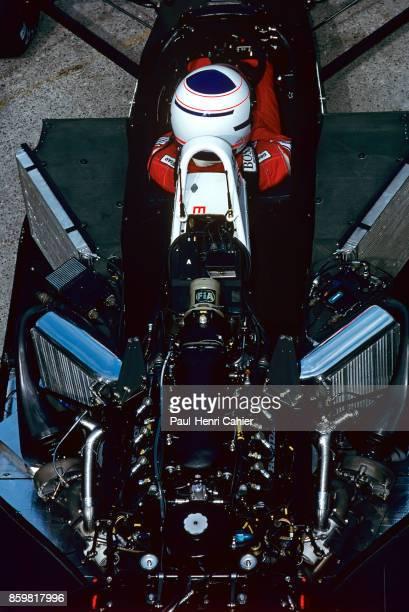 Alain Prost McLarenTAG MP4/2C Grand Prix of Hungary Hungaroring August 10 1986 The Honda RA168E 15 V6 turbo engine sits in the back of Alain Prost's...
