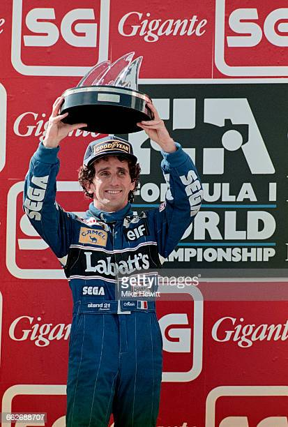 Alain Prost of France driver of the Canon Williams Renault Williams FW15C Renault V10 celebrates his second place in the race and winning his fourth...
