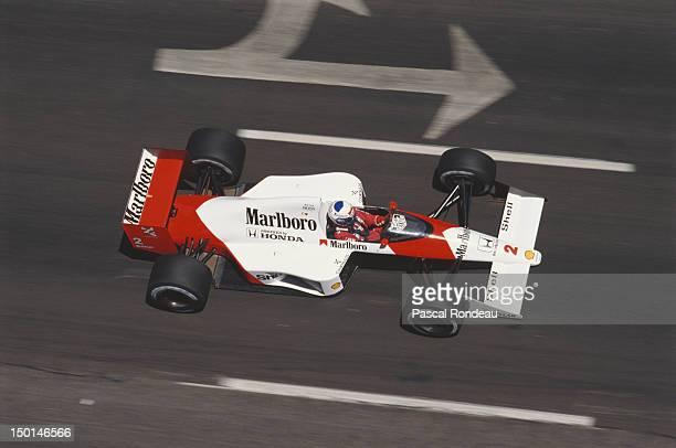 Alain Prost of France drives the Honda Marlboro McLaren MP4/5 Honda V10 during practice for the Iceberg United States Grand Prix on 3rd June 1989 at...