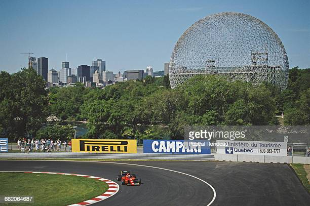 Alain Prost of France drives the Scuderia Ferrari F191 Ferrari V12 past the Biosphere from the 1967 International and Universal Exposition Expo 67...