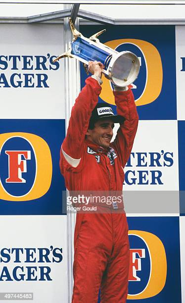 Alain Prost of France raises the trophy after winning the Australian Grand Prix at the Adelaide Street Circuit in Adelaide Australia 26th October...