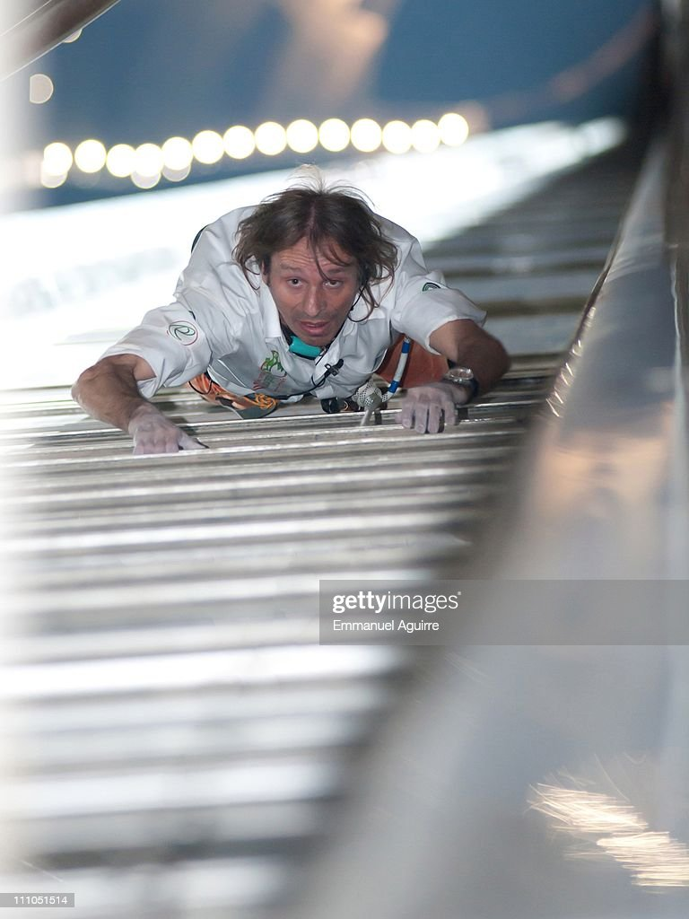 <a gi-track='captionPersonalityLinkClicked' href=/galleries/search?phrase=Alain+Robert+-+Climber&family=editorial&specificpeople=769748 ng-click='$event.stopPropagation()'>Alain Robert</a>, known as the French 'Spiderman' climbs the highest building in the world, Burj Khalifa on March 28, 2011 in Dubai, United Arab Emirates. Unlike many of Robert's recent climbs the ascent of the 828 metres (2,717 feet) tower was made using rope and harness as security precautions and received official recognition in marking the event 10th 'Education Without Borders'.