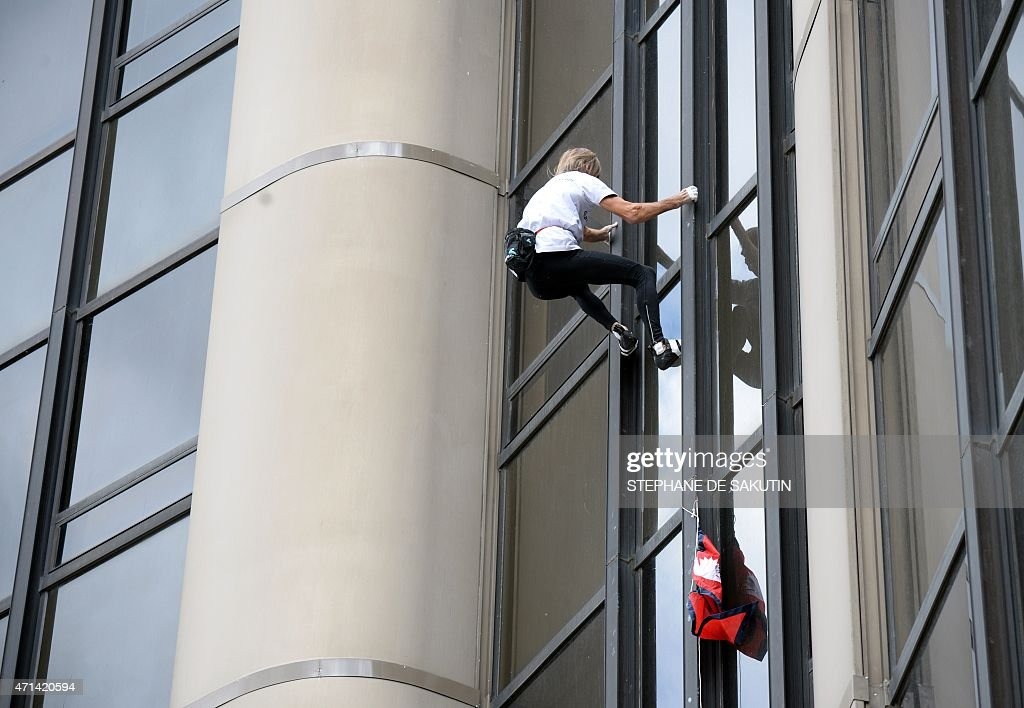 <a gi-track='captionPersonalityLinkClicked' href=/galleries/search?phrase=Alain+Robert+-+Climber&family=editorial&specificpeople=769748 ng-click='$event.stopPropagation()'>Alain Robert</a>, the French urban climber dubbed Spiderman, with a Nepalese flag in hand climbs the 210m (689 ft) Tour Montparnasse skyscraper on April 28, 2015 in Paris. Robert is holding a Nepalese flag in tribute to the victims of the earthquake that hit the country three days before.