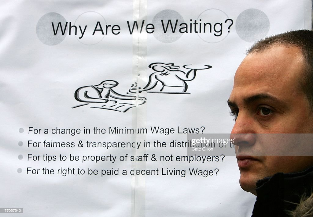 Alain Rossi a front of house restaurant worker protests against employers who pay less than the UK's minimum wage outside Pizza Express on September...