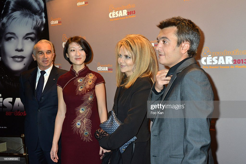 Alain Terzian, a guest, Nathalie Rheims and Thomas Langmann attend the Producer's Dinner - Cesar Film Awards 2013 at Georges V on February 18, 2013 in Paris, France.