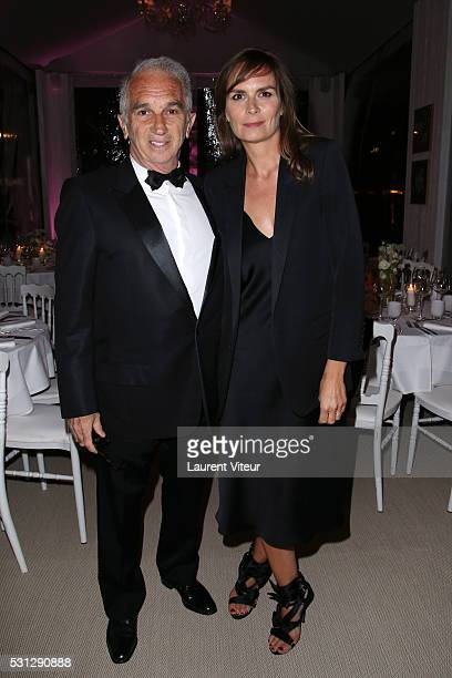 Alain Terzian and Brune de Margerie attend the Alain Terzian Dinner At the Petit Paris Beach at the annual 69th Cannes Film Festival at P on May 12...